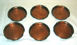 Carl Deffner six copper coasters set.